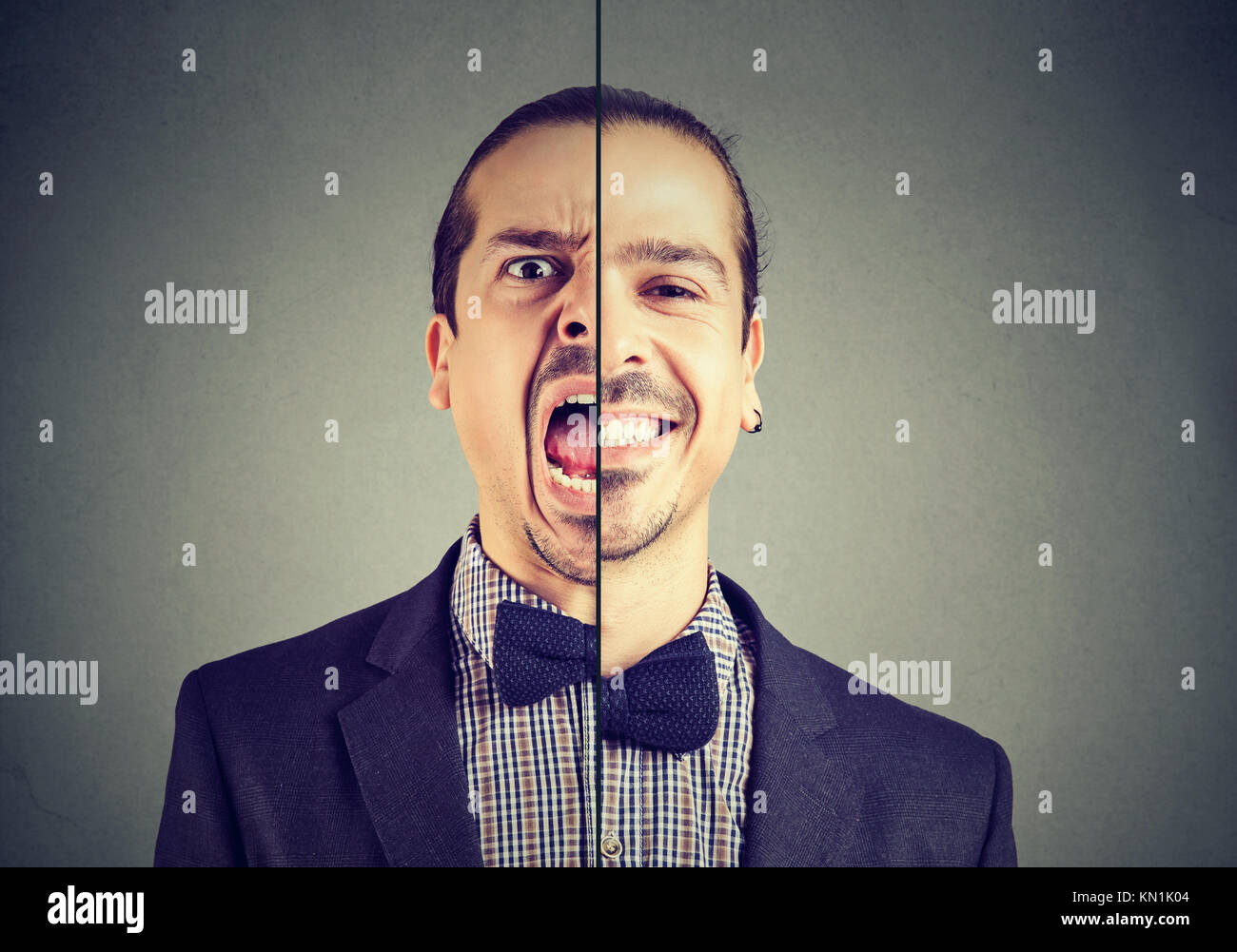 Bipolare Störung Konzept. Junge Geschäftsmann mit einem Gesichtsausdruck auf grauem Hintergrund Stockbild
