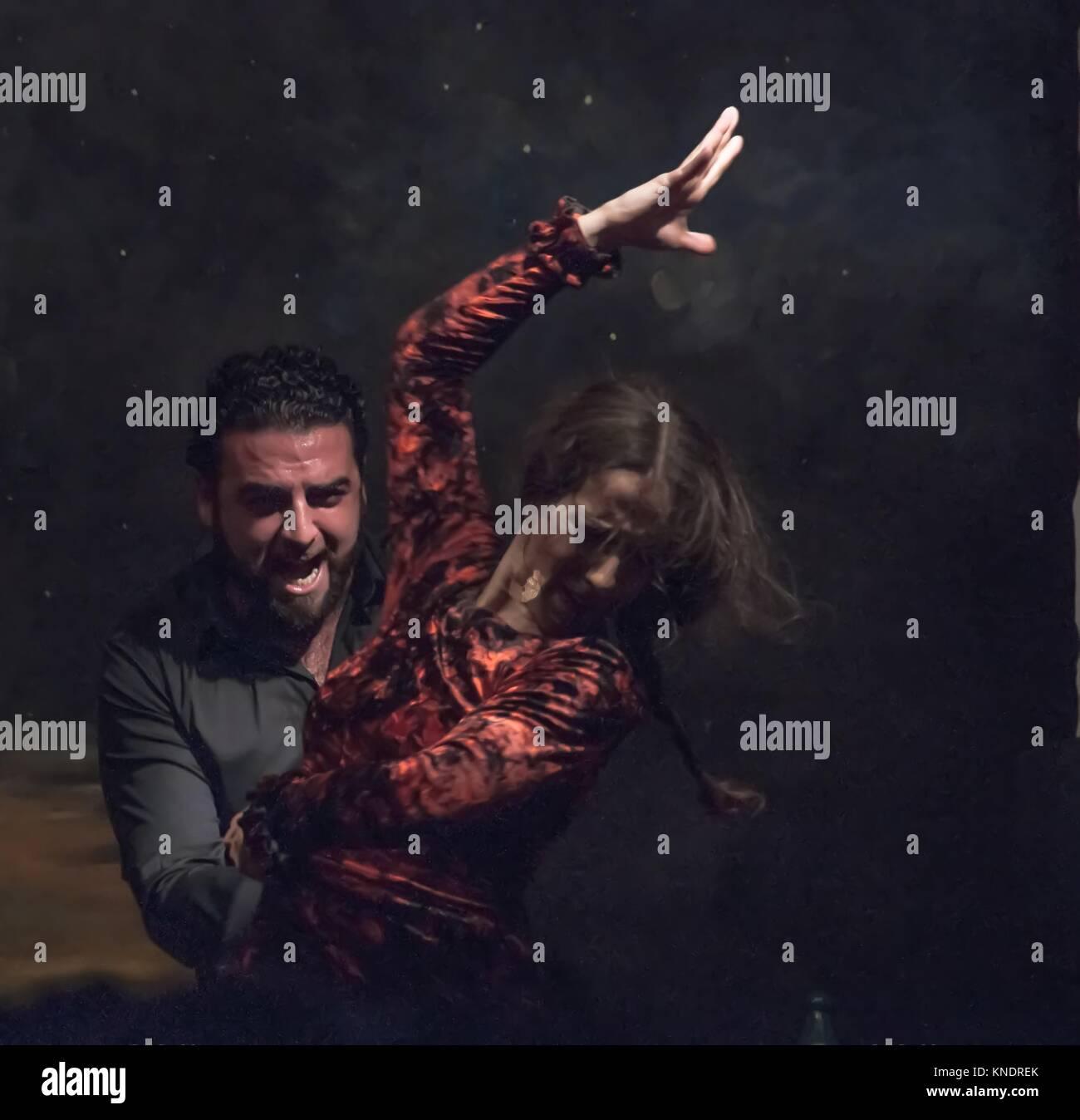 Leidenschaftliche Flamenco tanzen. Der Tänzer mit Zerzausten braunen Haar, ihr erhobenen Rechten Hand in helles Stockbild