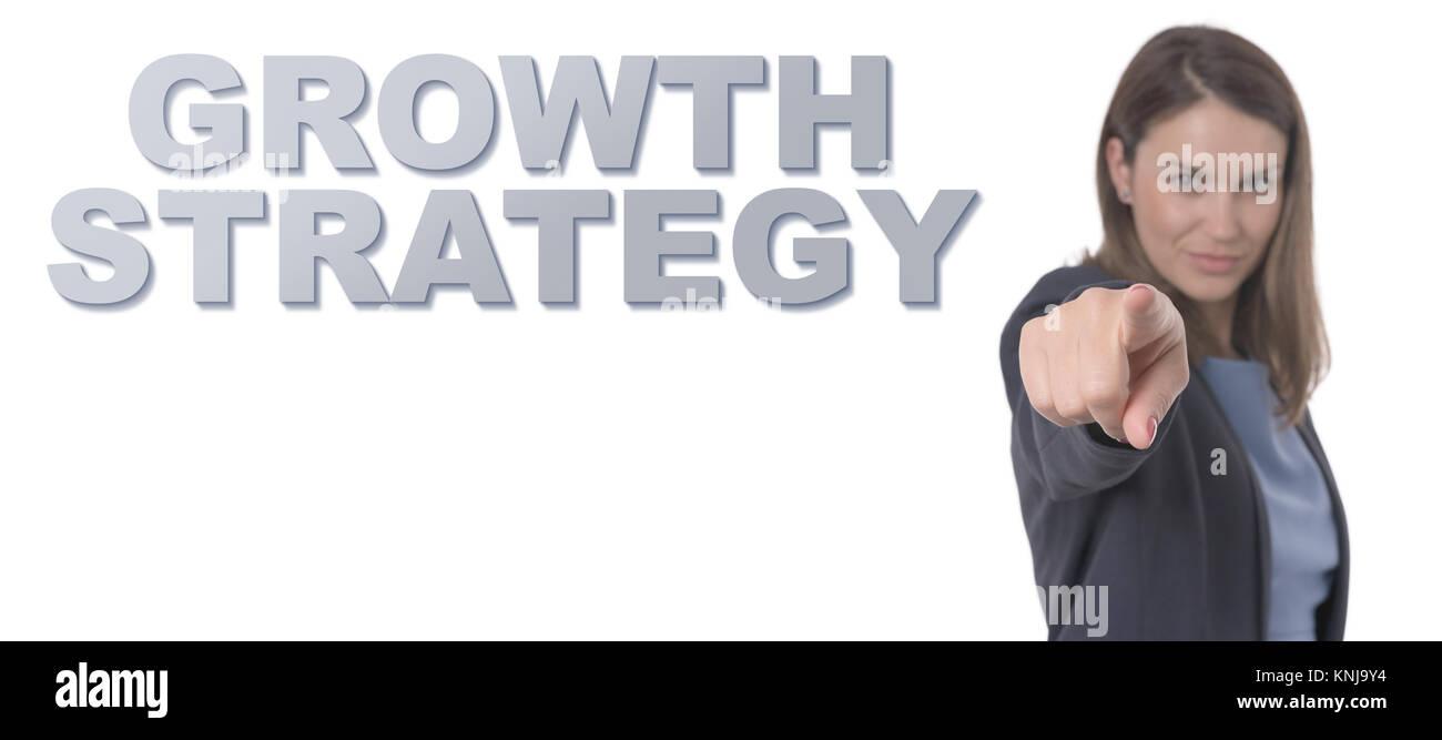 Business Frau zeigt den Text WACHSTUMSSTRATEGIE KONZEPT Business Konzept. Stockfoto