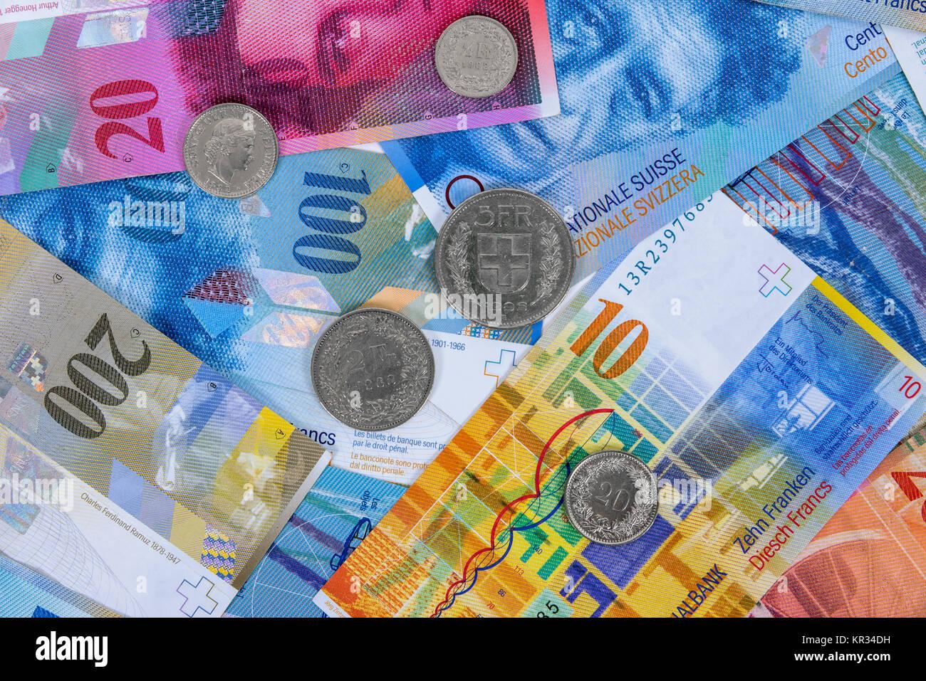 schweizer franken banknoten und m nzen als hintergrund stockfoto bild 169099773 alamy. Black Bedroom Furniture Sets. Home Design Ideas