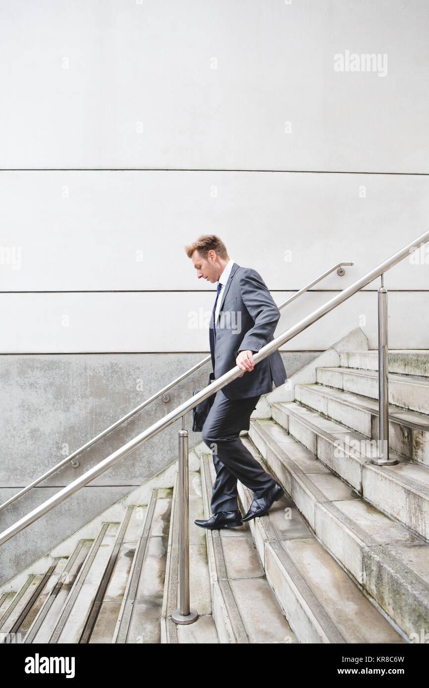 Geschäftsmann auf der Treppe Stockbild
