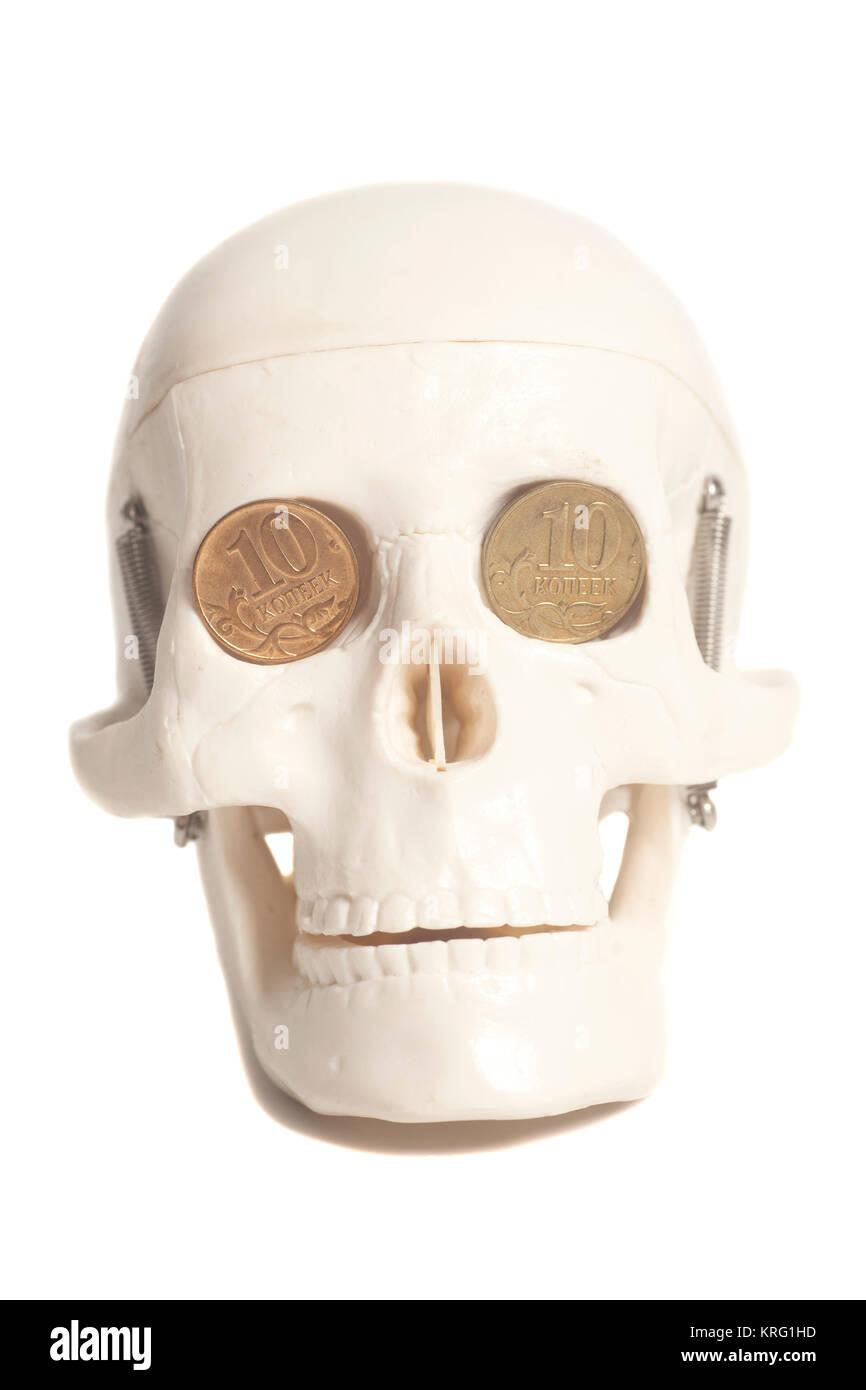Menschlicher Schädel Mit Geld Münzen Anstelle Der Augen Stockfoto