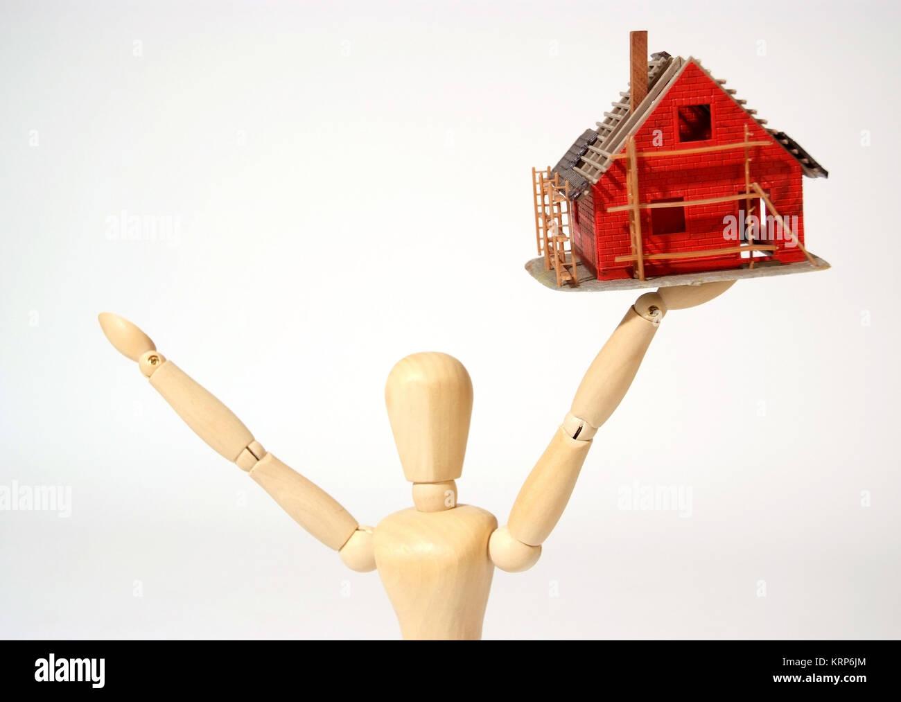 Symbolbild Jubel Fischland Eigenheim, Haeuselbauer - symbolische zur Freude für neues bauen Haus Stockbild