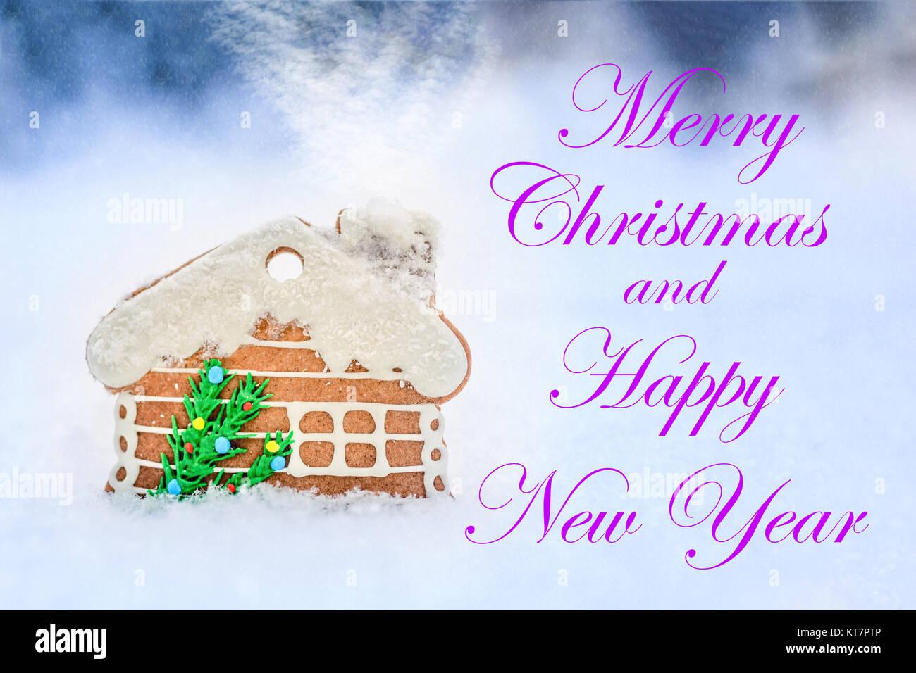 Lebkuchenhaus auf Schnee im Hintergrund, Weihnachtskarte, Schnee und ...