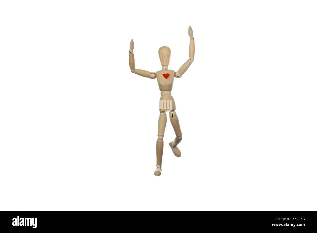 Hölzerne Puppe gewann ein Rennen mit einem roten Herzen, konzeptionelle Foto über gesunde Lebensweise üben einen Sport Stockfoto
