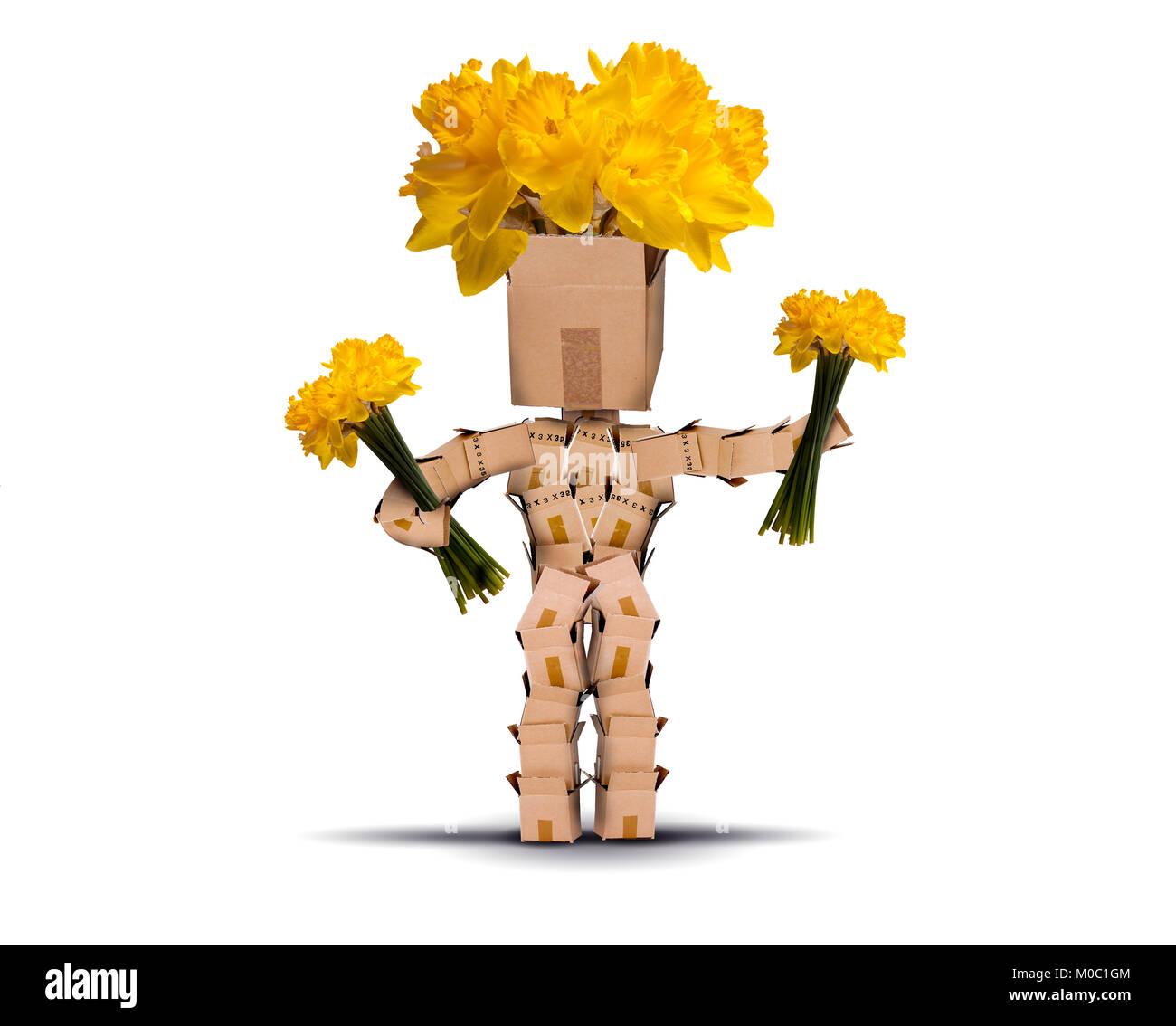 Box Charakter Holding und hat gelbe Blüten Narzissen für die Haare. Auf einem weißen Hintergrund. Stockbild