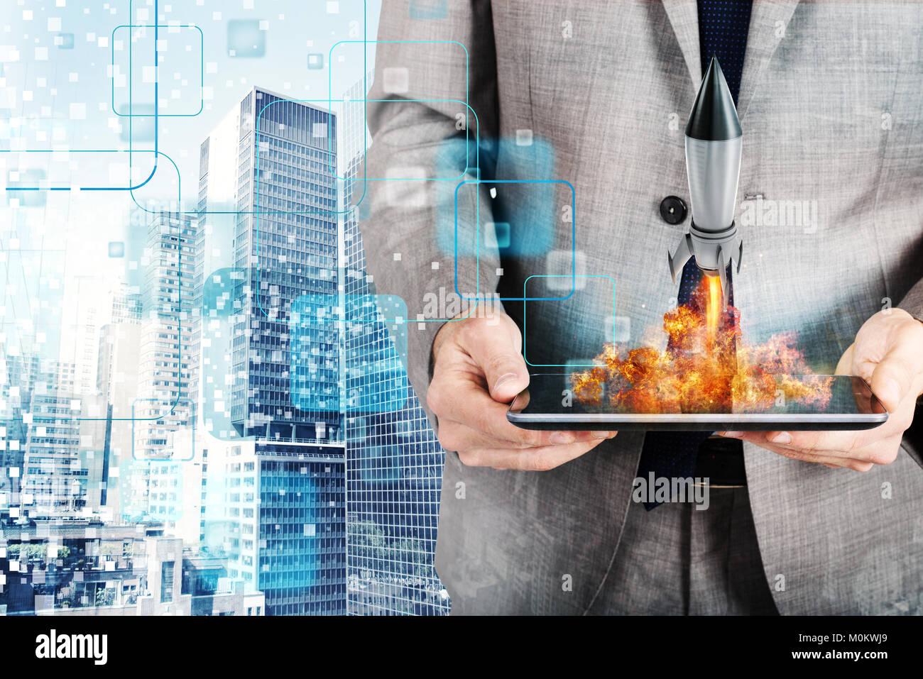 Geschäftsmann startet Rakete von einem Tablet. Konzept der Unternehmensgründung Stockbild