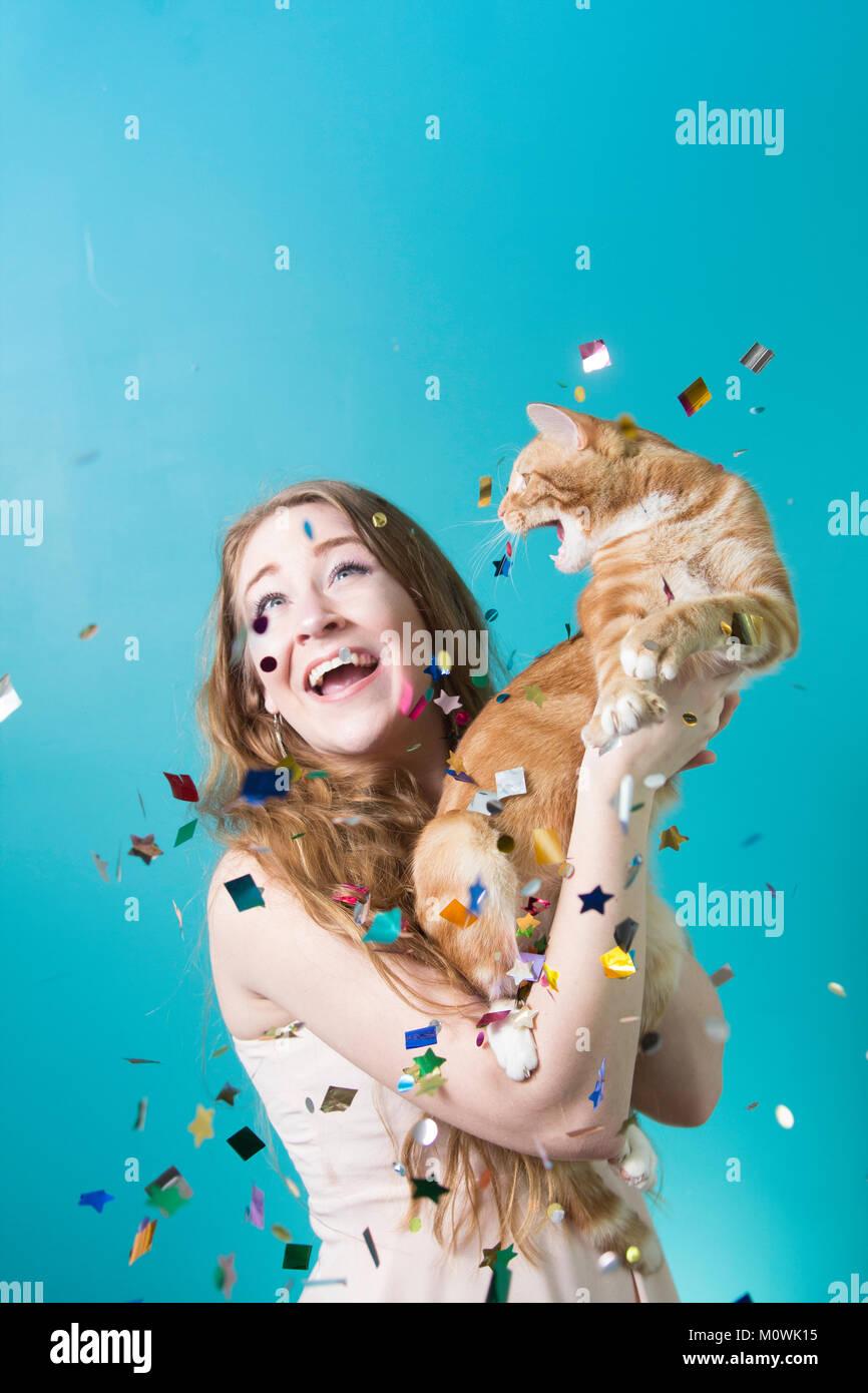 Überraschungsparty Cat Stockbild