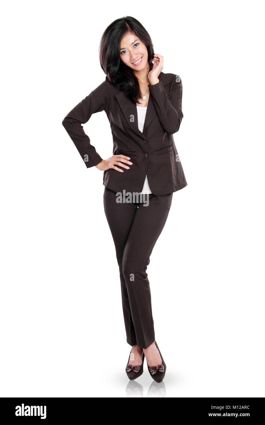 Voller Körper Portrait von lächelnden schönen jungen Geschäftsfrau auf weißem Hintergrund Stockbild