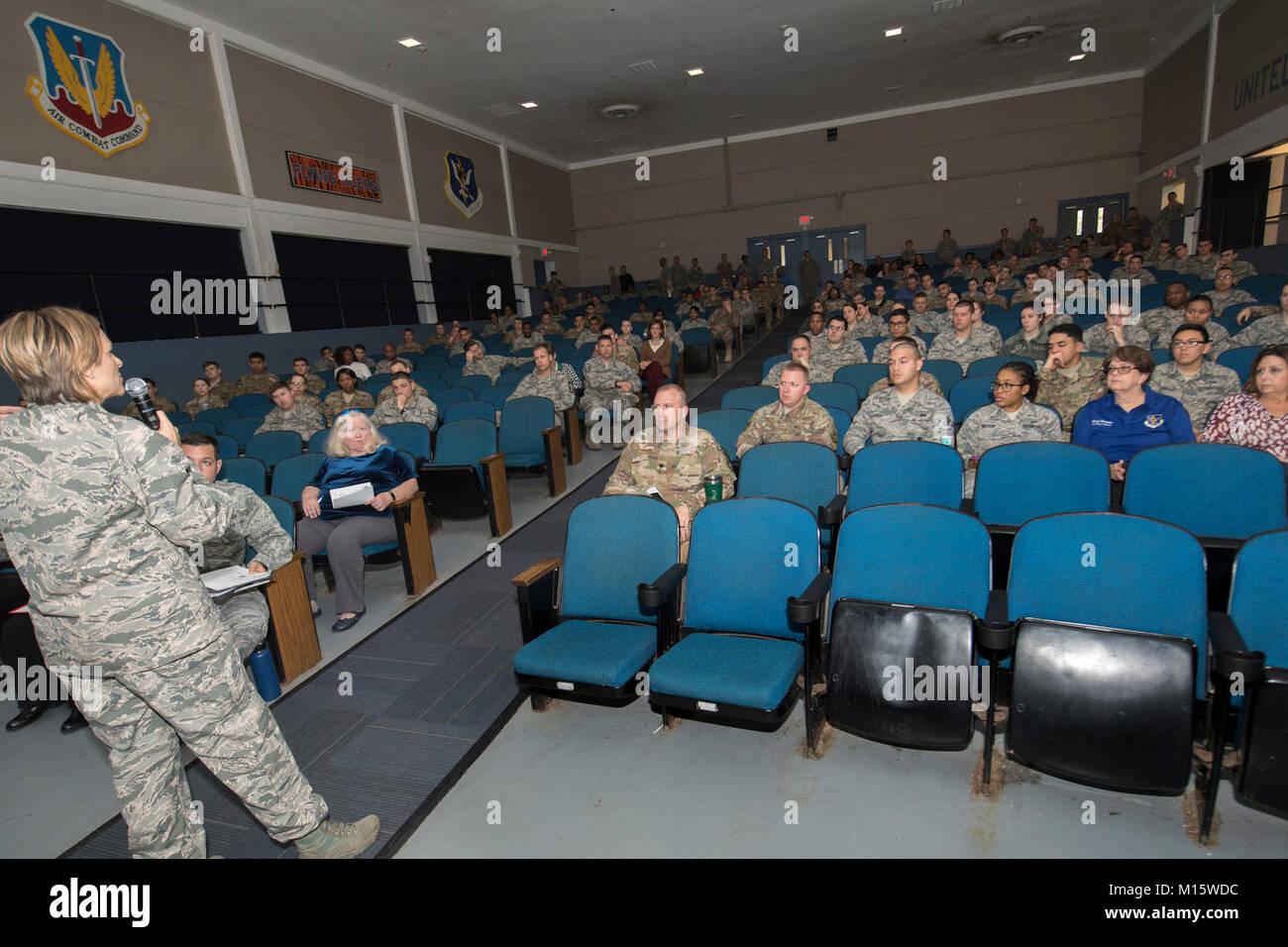 Col. Jennifer Short, 23d Wing commander, looks inside the