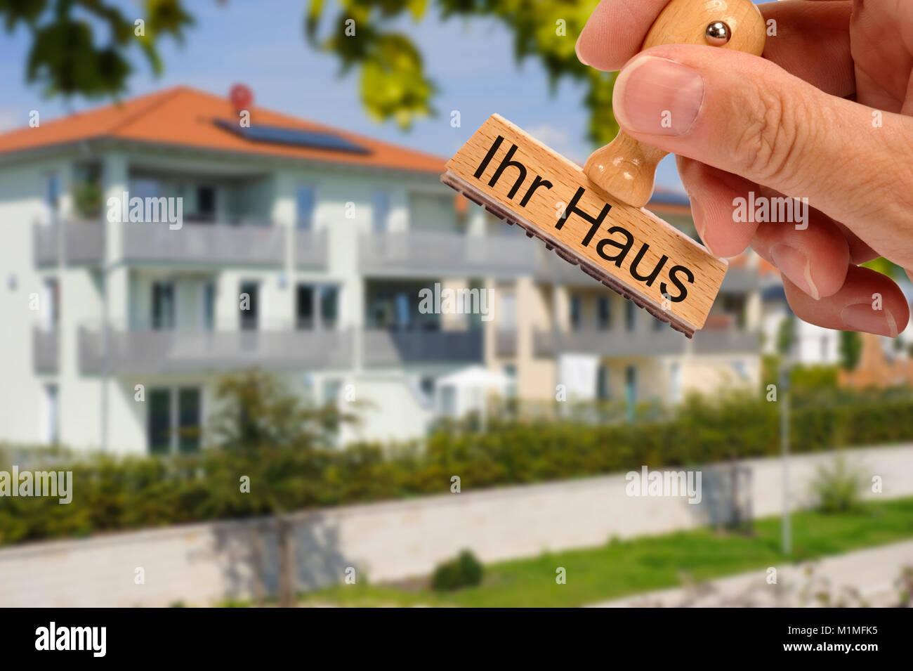 Haus für Verkauf auf Stempel gedruckt Stockbild