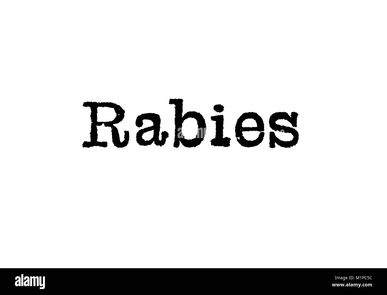 Das Wort Tollwut von einer Schreibmaschine auf weißem Hintergrund Stockbild