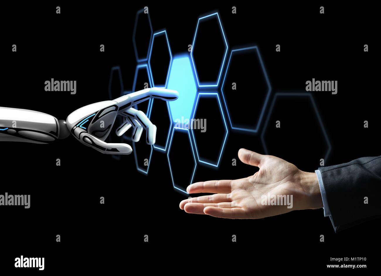 Die menschliche Hand und Roboter berühren Netzwerk Hologramm Stockbild