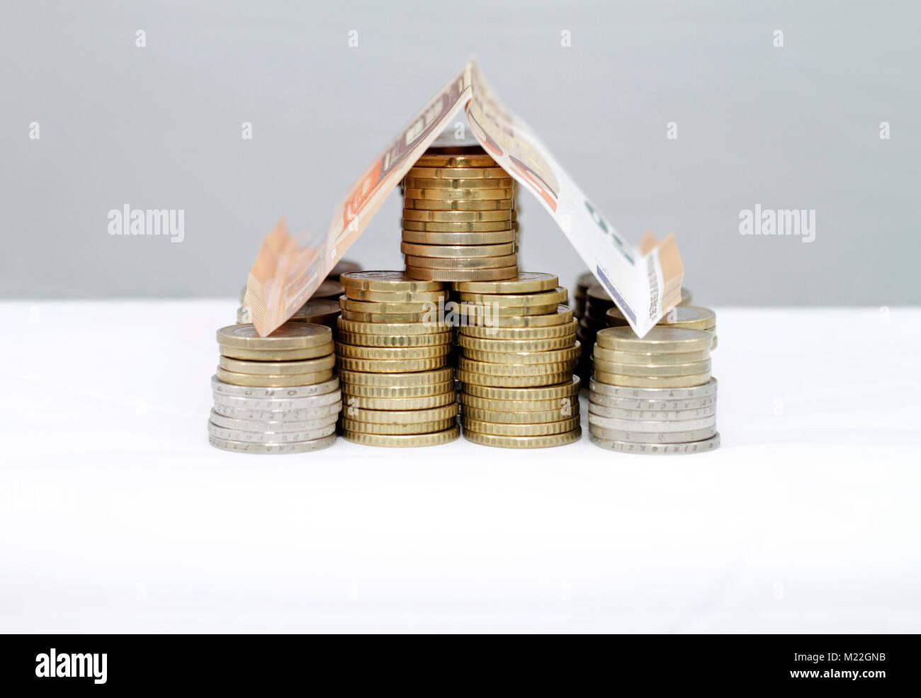 Haus aus Geld - Hypotheken und Finanzierungen Stockbild