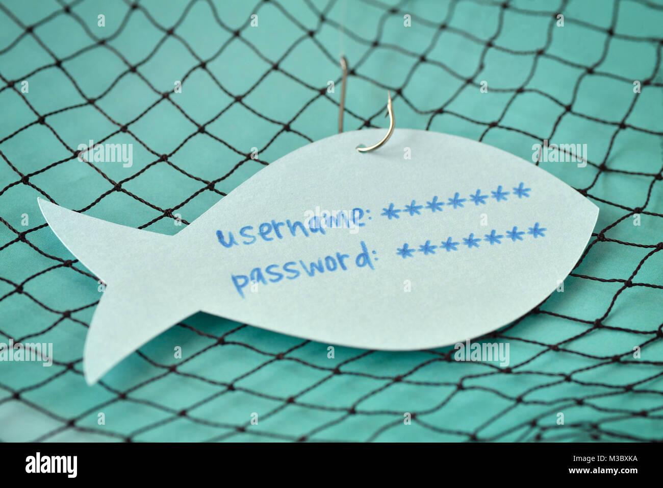Benutzernamen und Kennwort auf einem Papier Hinweis in Form eines Fisches zu einem Haken geschrieben - Phishing Stockfoto