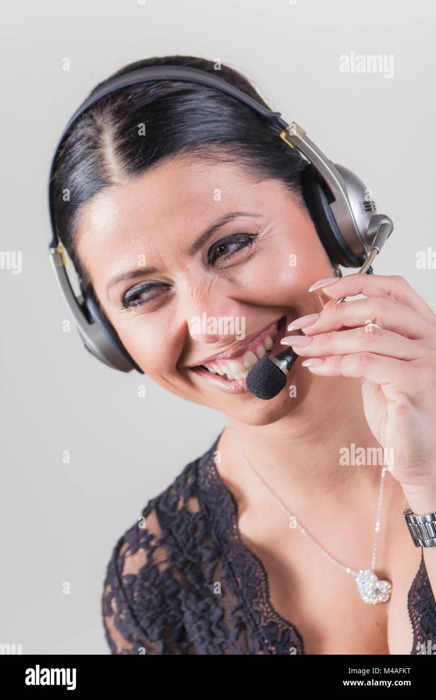 Fröhlich Customer service agent Telemarketing Dame Stockbild