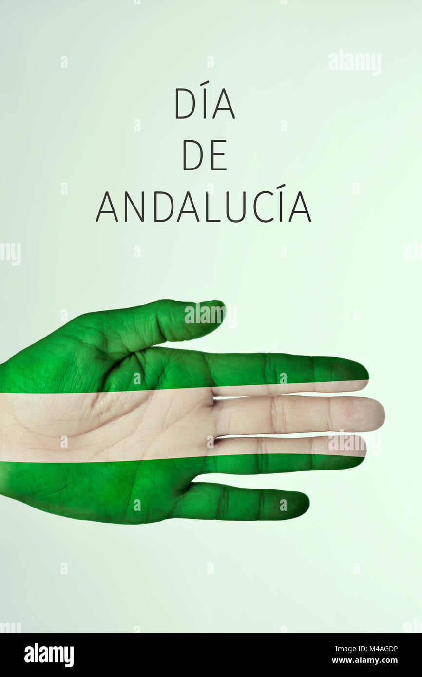 Der text Dia de Andalucia, Andalusien in Spanisch, und die Hand eines jungen Mannes mit der Flagge Andalusiens Gemusterten, Stockbild
