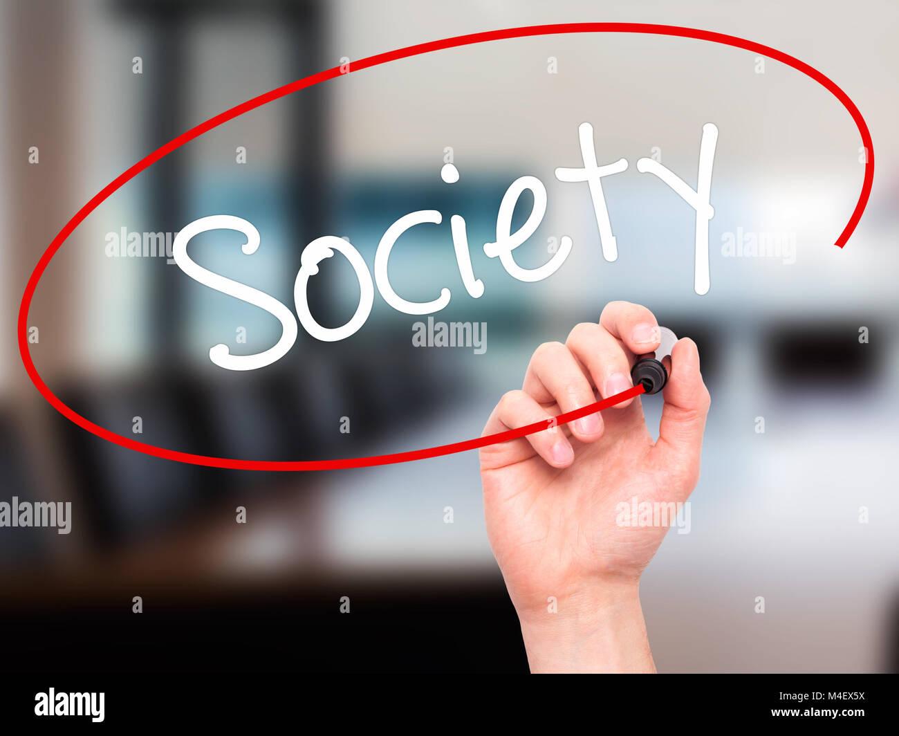 Mann Hand schreiben Gesellschaft mit schwarzem Marker auf visuelle Bildschirm Stockbild