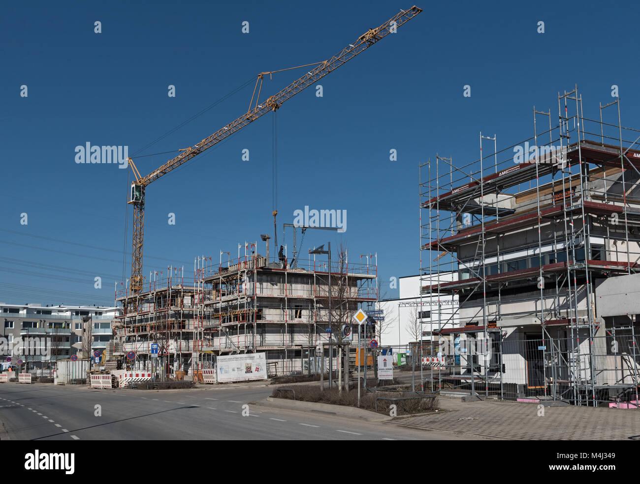 Baustelle von mehreren Wohngebäuden in den neuen Stadtteil Riedberg Stockbild