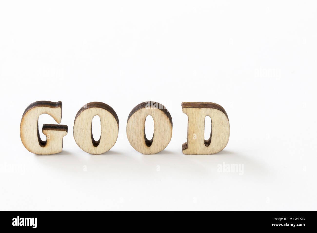 Gut, gut Holz Buchstaben auf weißem Hintergrund Stockbild