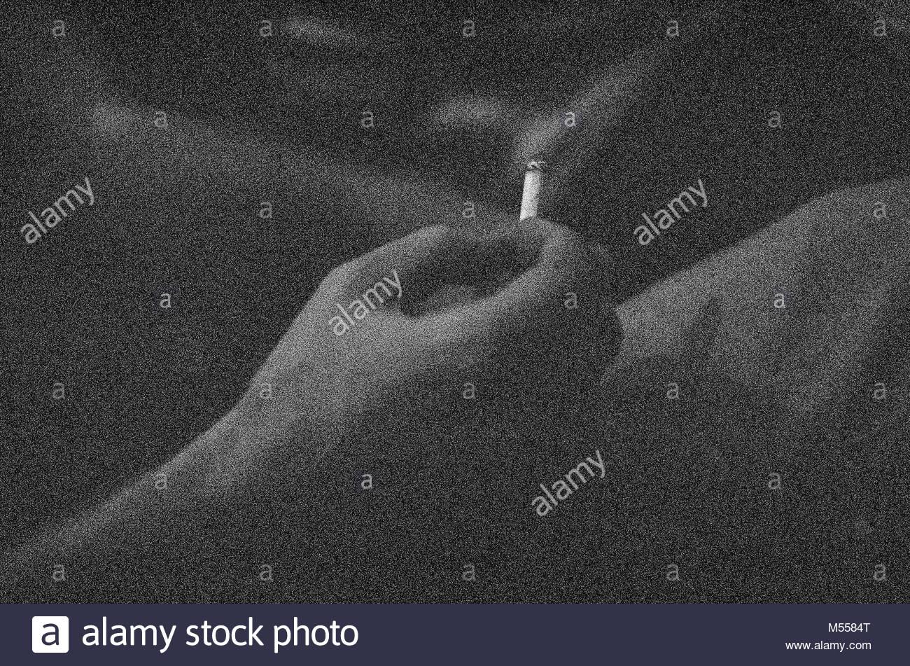 Zigarette in einer Hand Stockbild