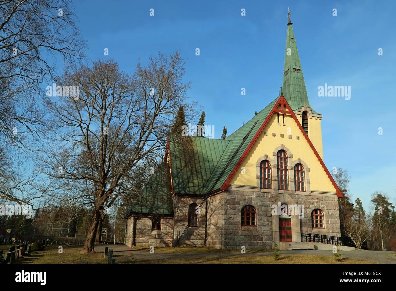 Das schöne steinerne Kirche von Humppila, Finnland wurde 1922 abgeschlossen, und es stellt die finnische Nationalromantik Stockbild