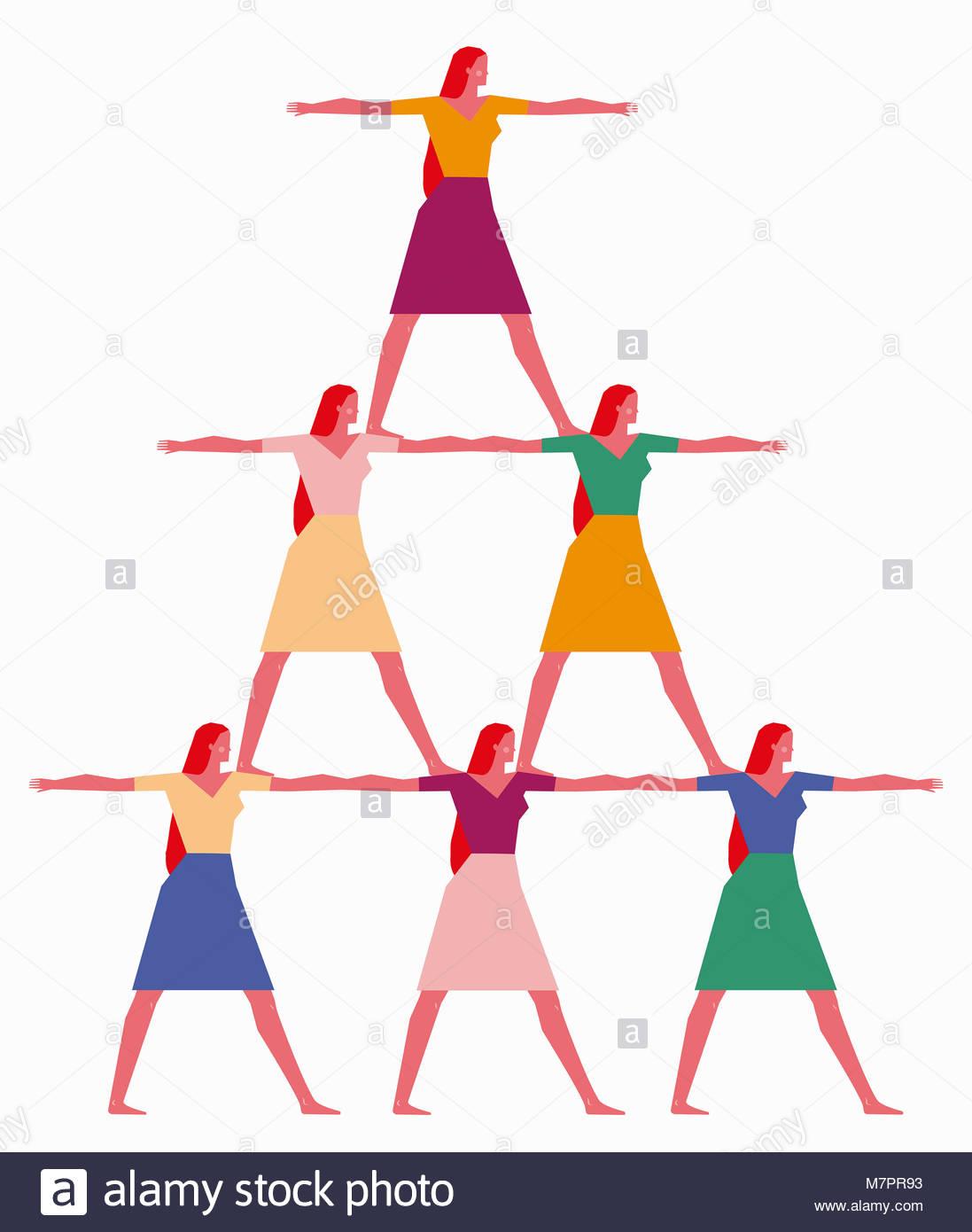 Frauen bilden menschliche Pyramide Stockbild