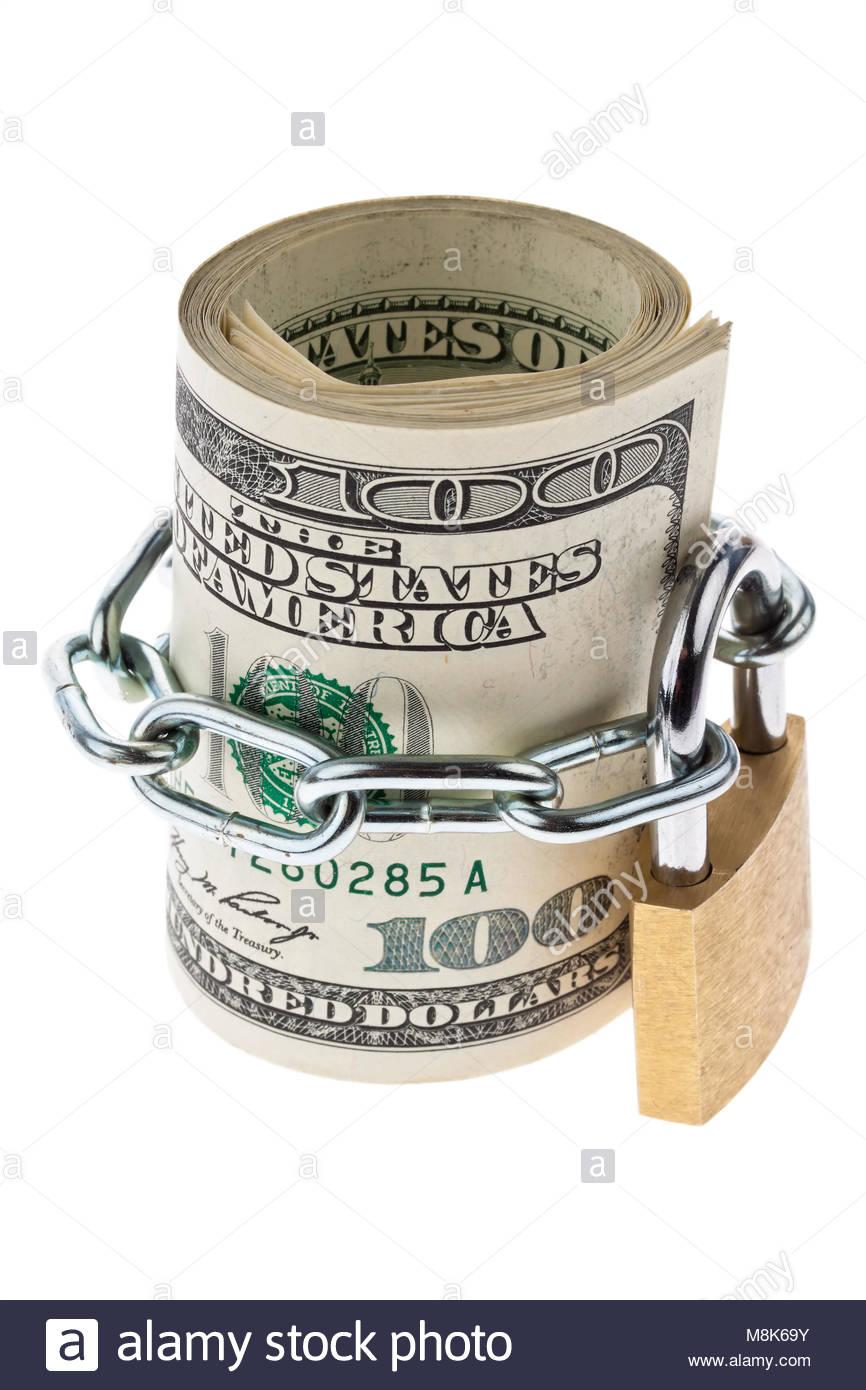Viele Dollarscheine sind mit einem Schloss verriegelt Stockbild