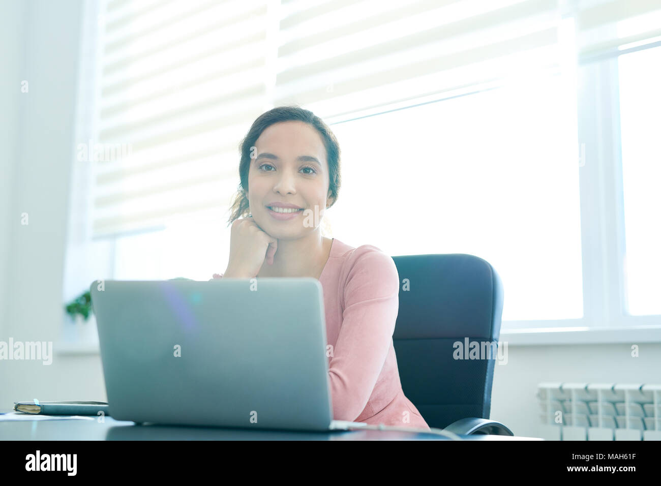 Happy Hispanic Office Manager Stockbild