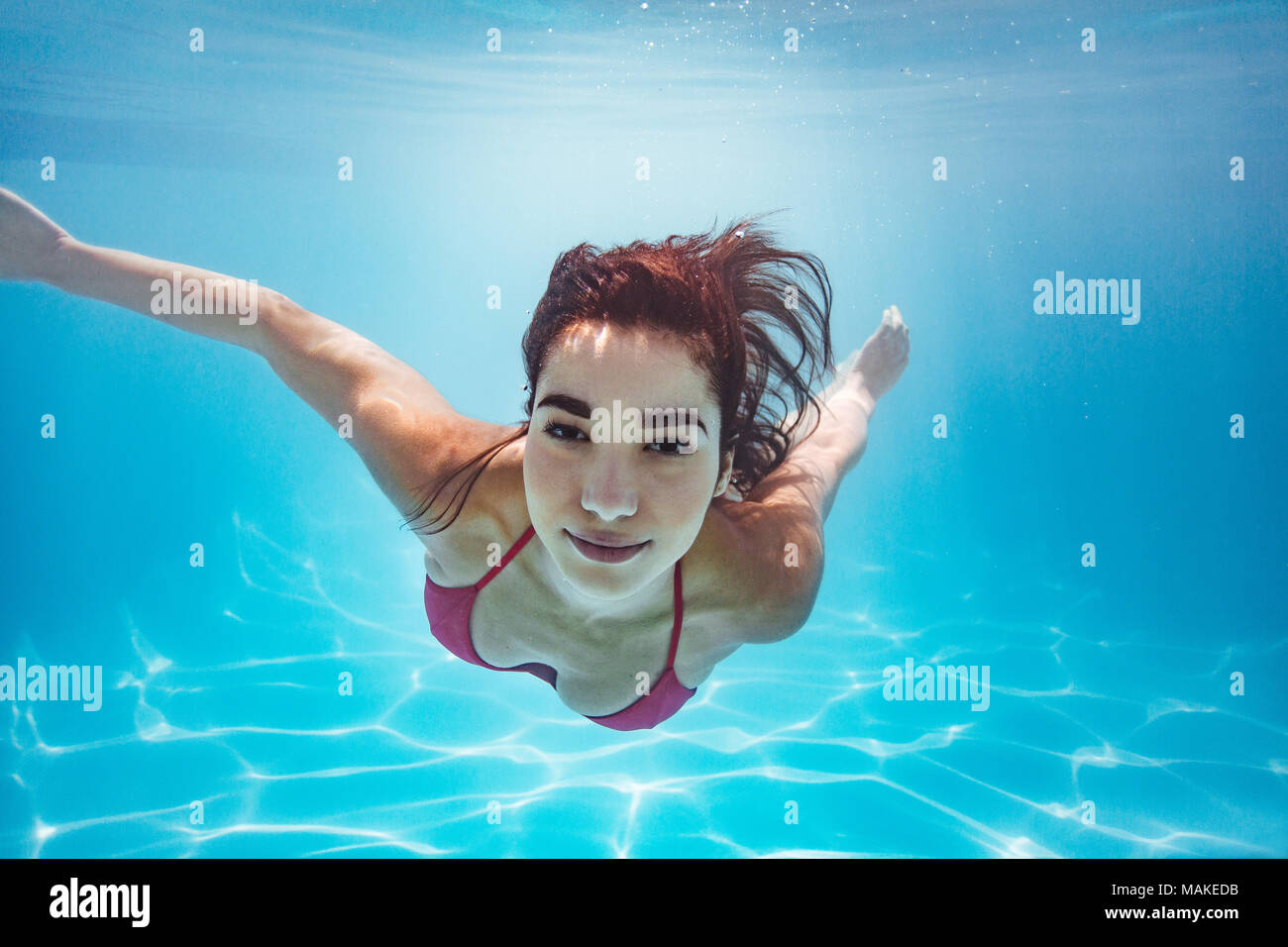 hotel woman underwater in pool stockfotos hotel woman. Black Bedroom Furniture Sets. Home Design Ideas