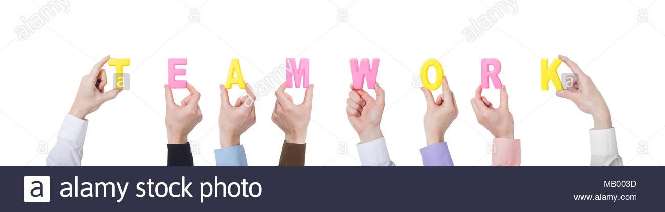 Die Unternehmer zeigen bunte Buchstaben und Teamarbeit Stockbild