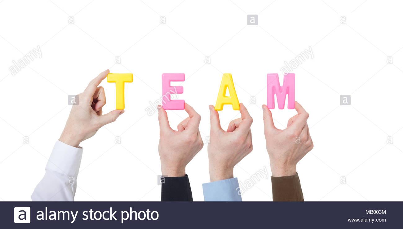 Die Unternehmer zeigen bunte Buchstaben und Gebäude team Stockbild