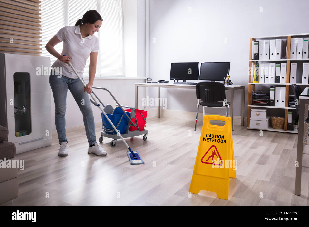 caution wet floor sign on stockfotos caution wet floor sign on bilder alamy. Black Bedroom Furniture Sets. Home Design Ideas