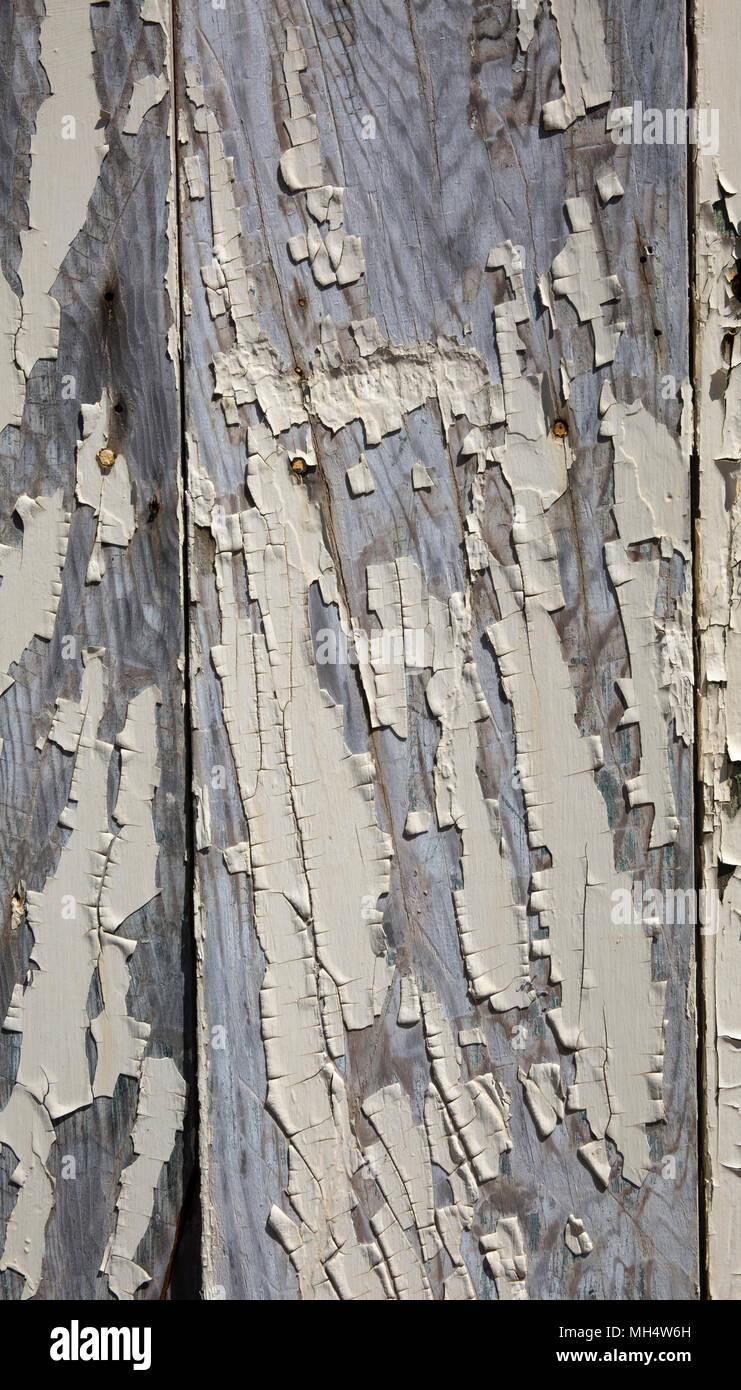 Risse abgeplatzte Farbe auf Holz Stockbild