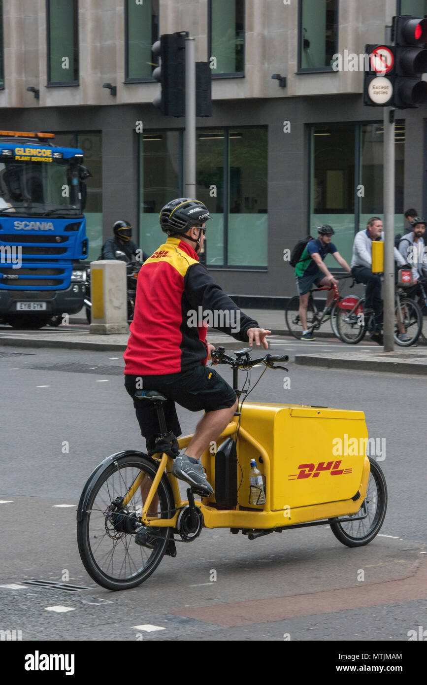 Delivery Man Riding Bicycle In Stockfotos Delivery Man Riding