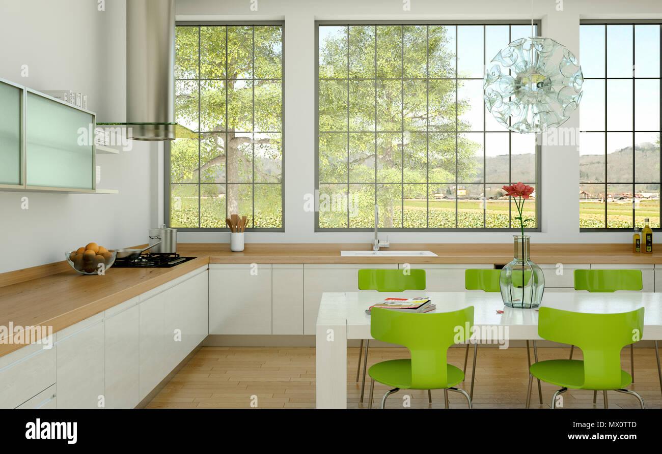 Weiss Moderne Kuche In Einem Haus Mit Grune Stuhle Und Tisch Stockfotografie Alamy