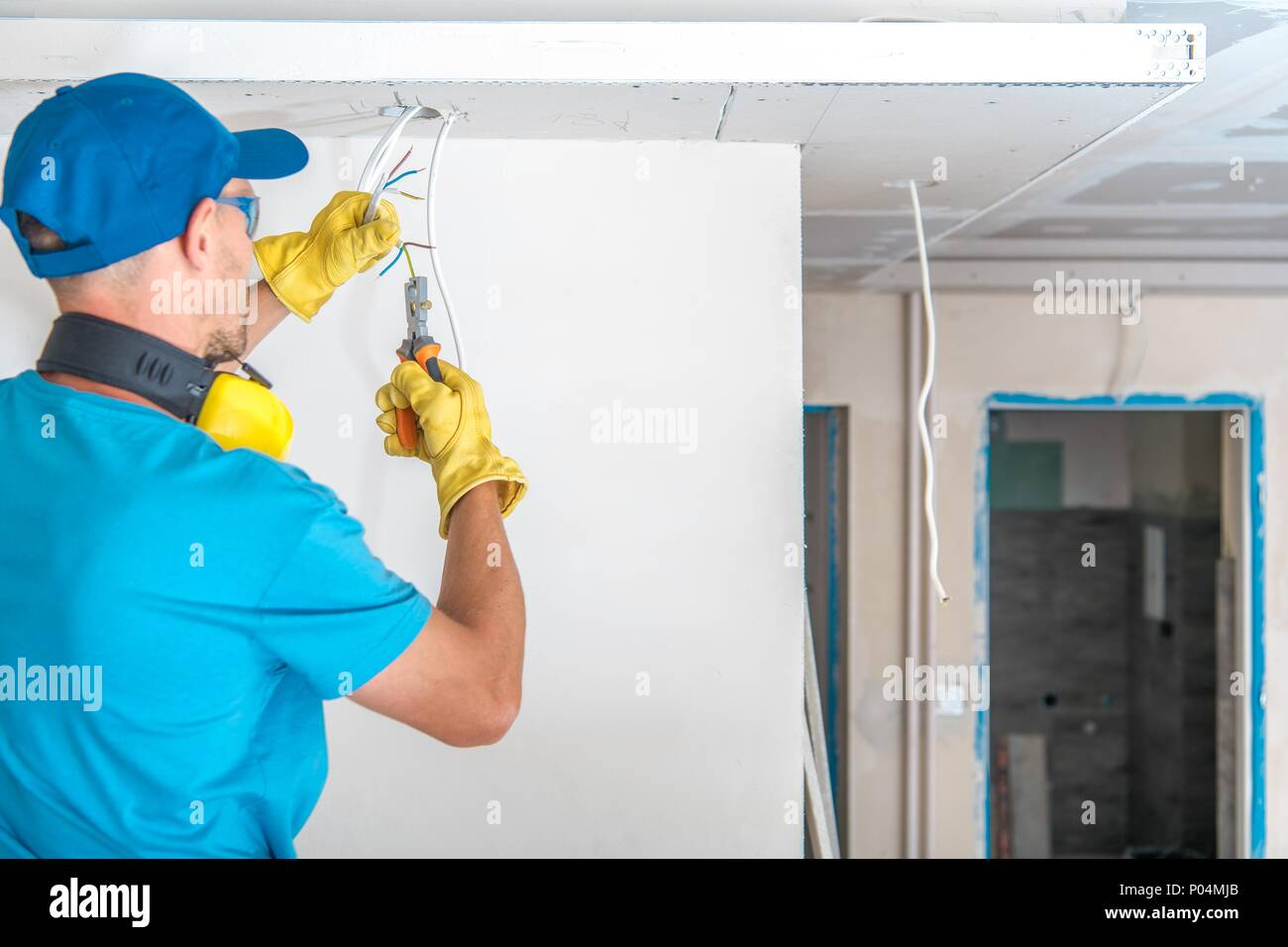 Electrician Working Electric Box House Stockfotos & Electrician ...