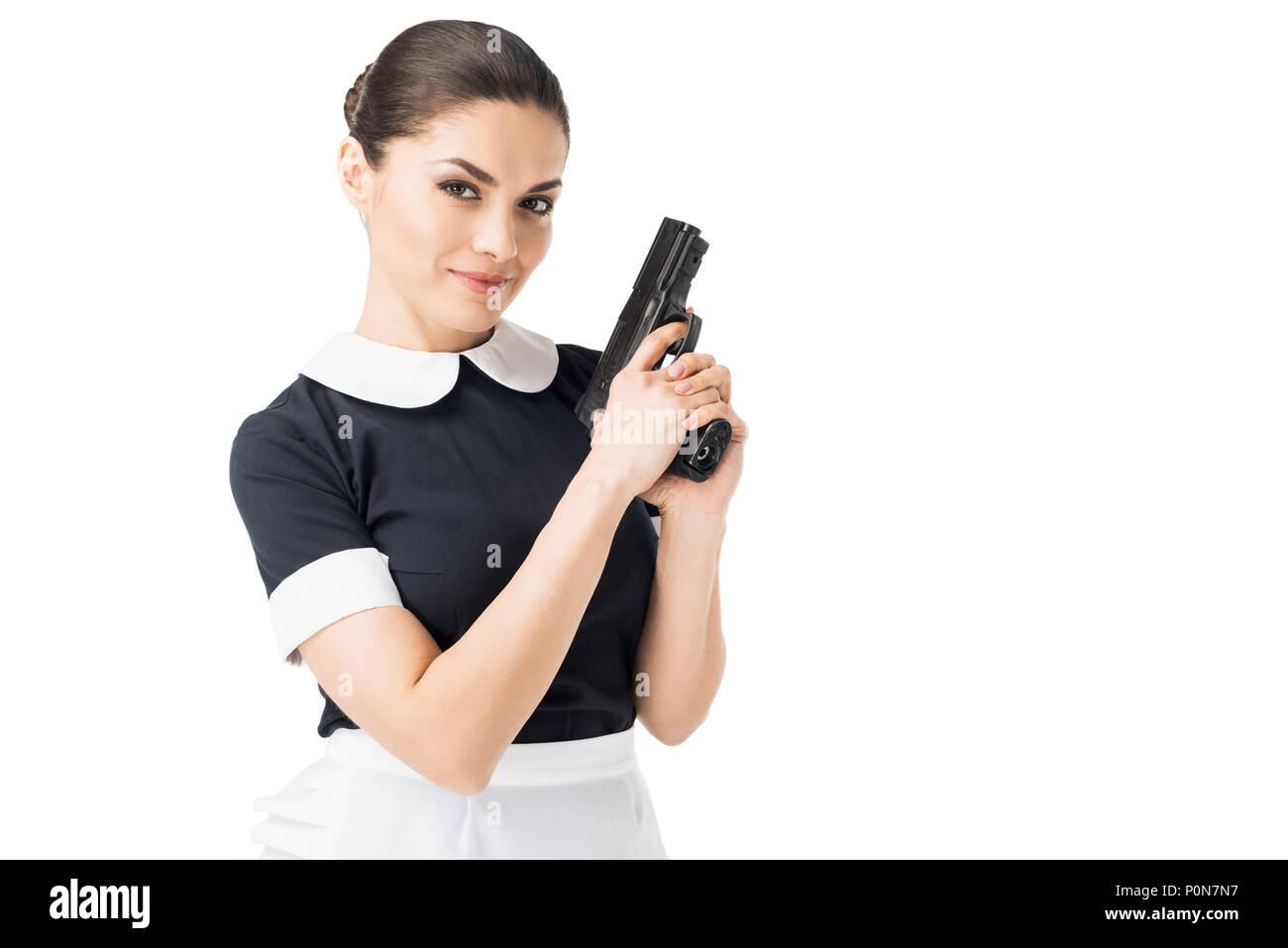Junge Mädchen in Uniform holding Gun isoliert auf weißem Stockfoto