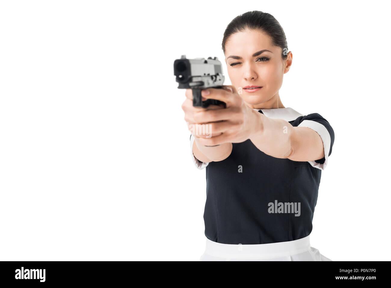 Lächelnde Frau in professionellen Maid Uniform isoliert auf weißem Stockfoto