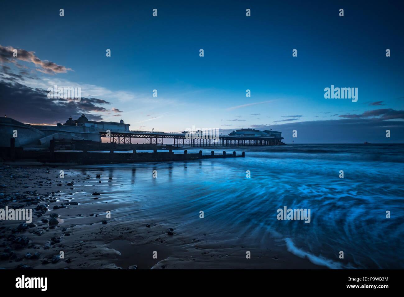 Am Ende des Tages bei Cromer Pier Stockbild
