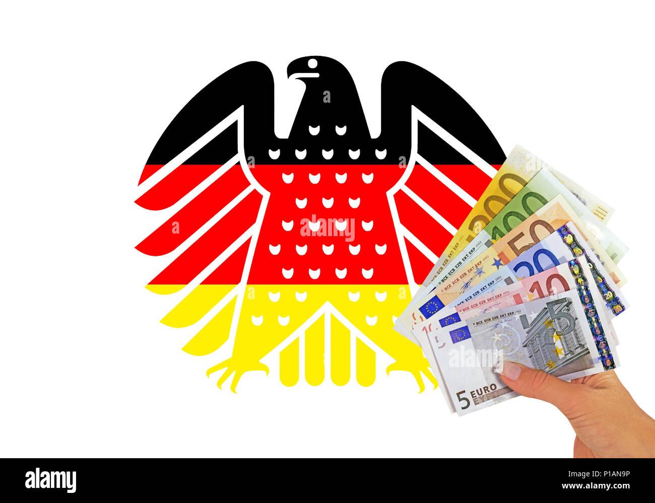 Neue bundesadler in den Farben schwarz - rot - Gold, das Wappentier der Bundesrepublik Deutschland, vor der Hand mit Banknoten,, Neuer Bundes Stockbild