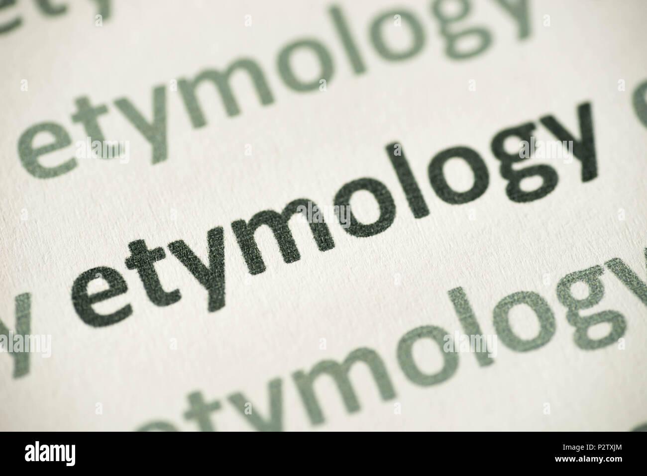Wort Etymologie auf weißem Papier Makro gedruckt Stockbild