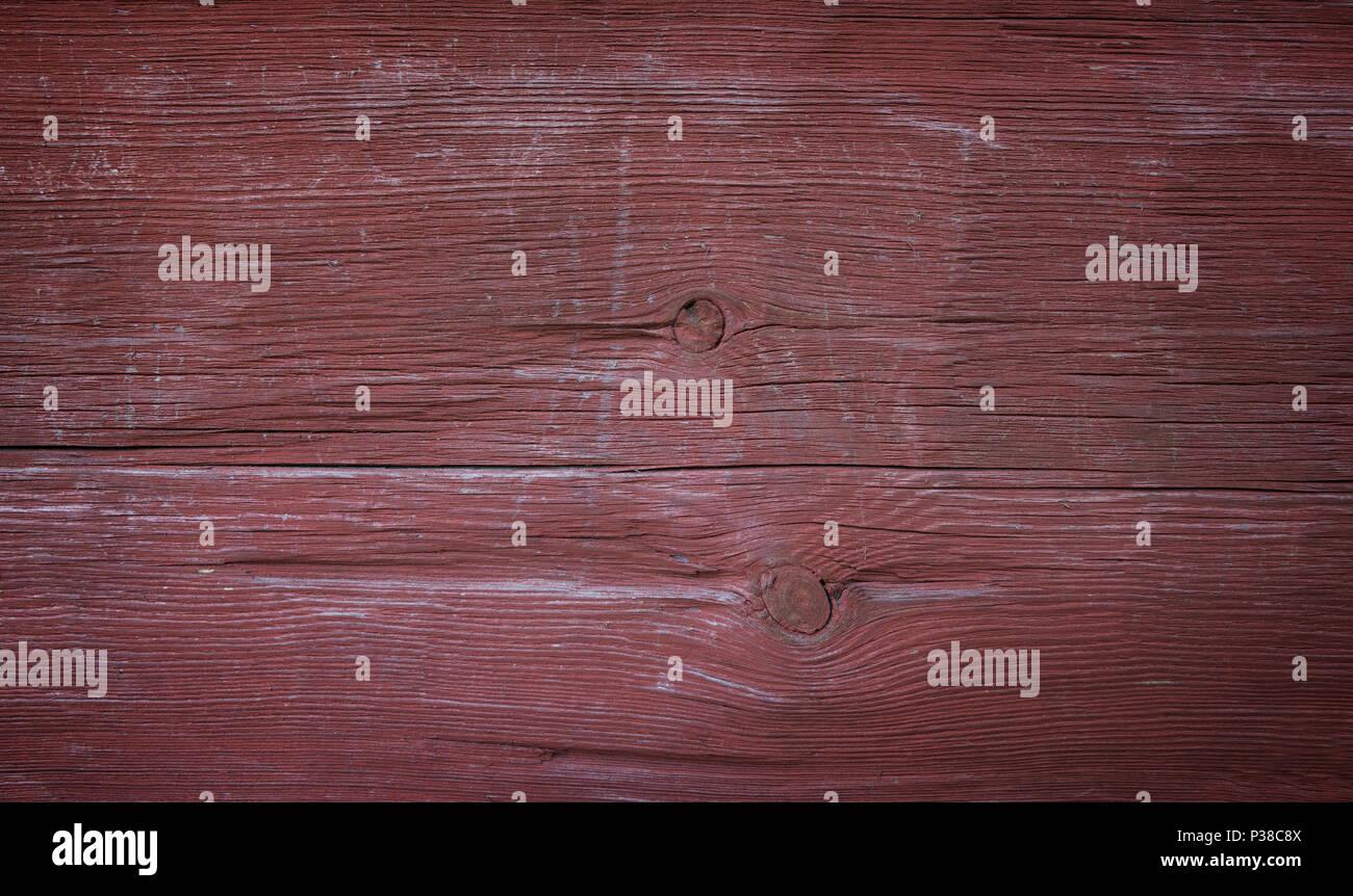 Nahaufnahme eines alten und verblasste Holz board Wand in Rot mit ...