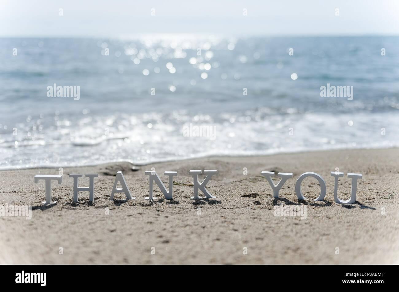 Vielen Dank, dass Sie Wort am Strand Sand gezeichnet Stockfoto