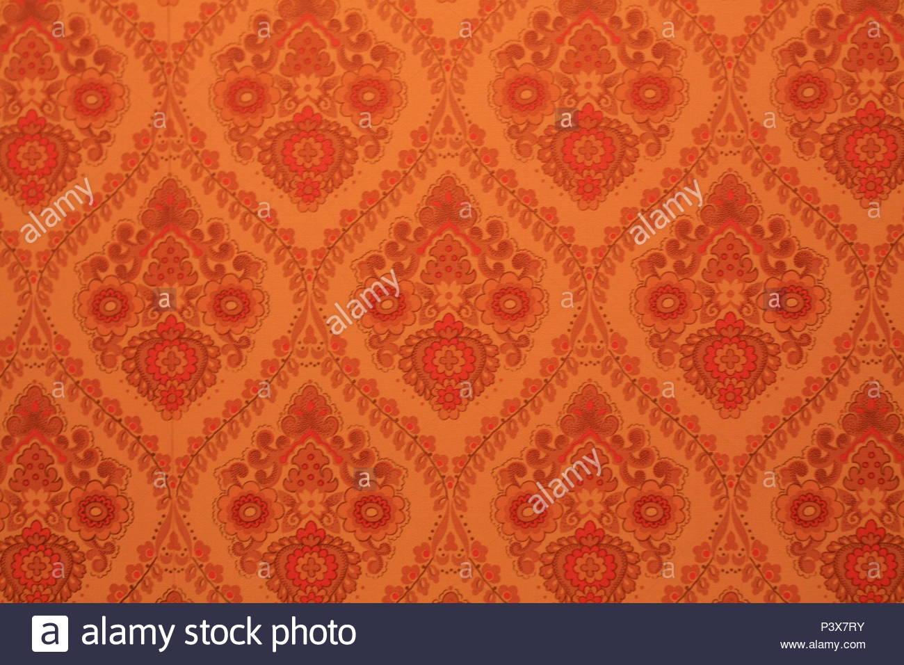 Orange 70er Jahre Tapete mit wiederkehrenden Paisley-muster ...