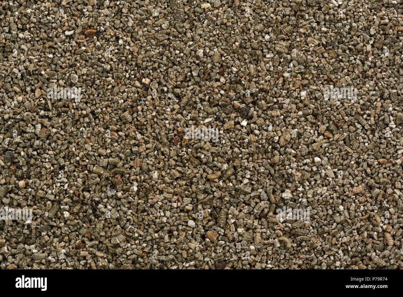 Vermiculit Partikel, Boden Änderungsantrag Mineral in Gartenbau und Gartenbau. Closeup Textur Hintergrund Stockbild