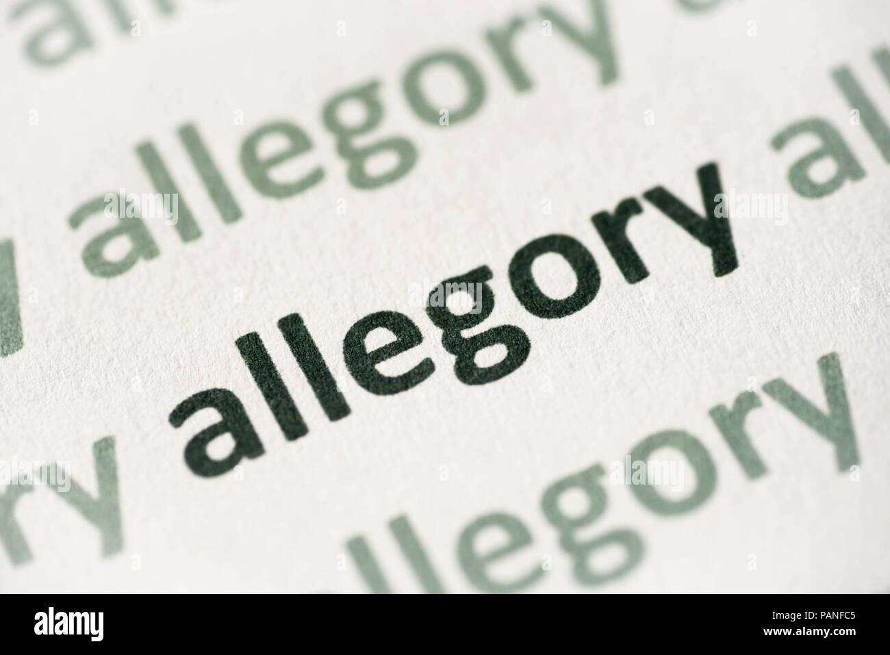Wort Allegorie auf weißem Papier Makro gedruckt Stockbild