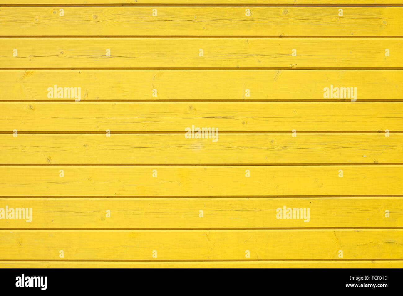 Holz- wand von horizontal angeordneten gelb lackierte Bretter, Hintergrundbild Stockbild