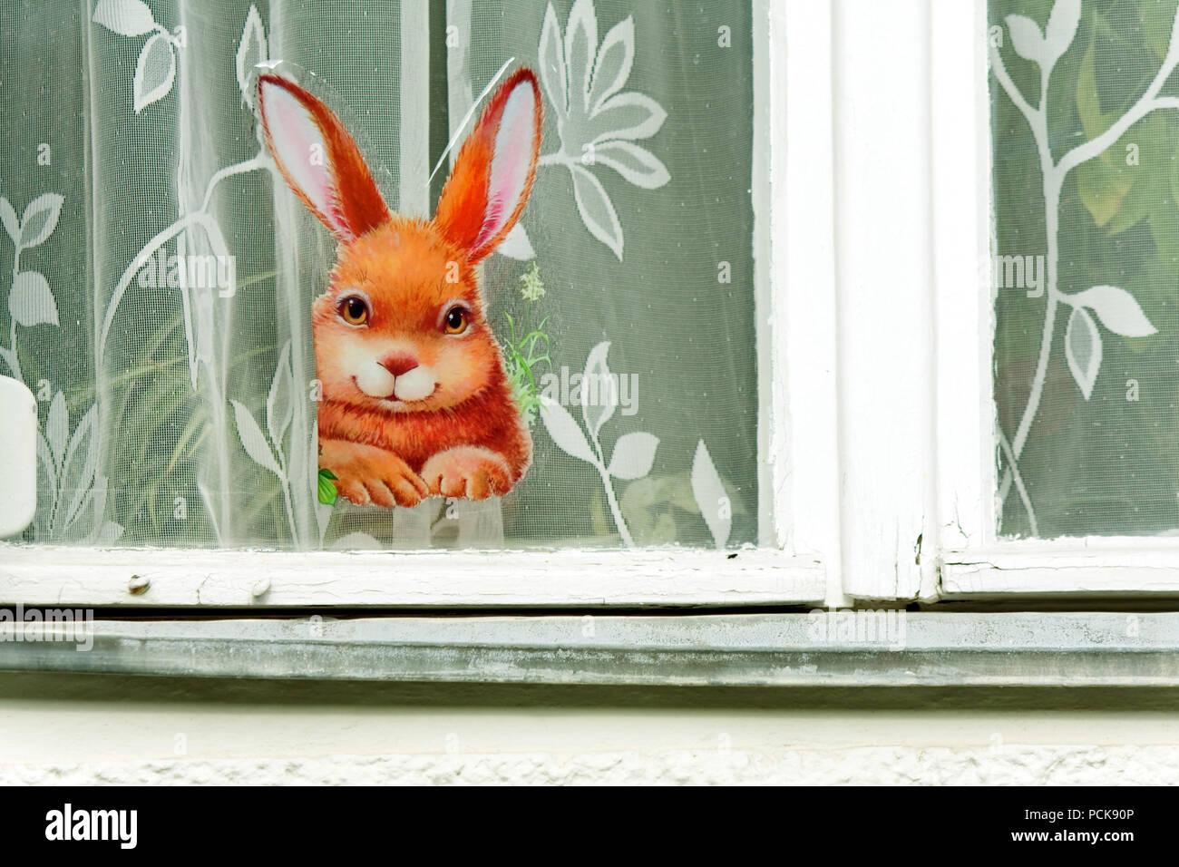 Osterhasen, Osterdekoration, Fensterglas Stockbild