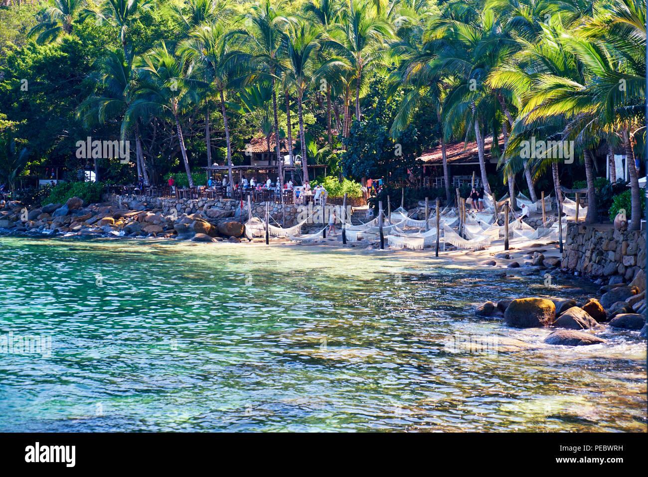 Hängematten und Bars am Strand zurückziehen, Las Caletas, Jalisco, Mexiko Stockbild
